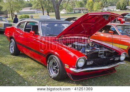 Red Ford Maverick Grabber