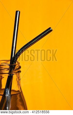 Reusable Metal Straws On Yellow Background - Stainless Steel, Eco-friendly Drinking Straw Set. Zero