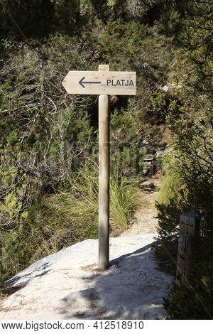 Macarelleta, Menorca / Spain - June 25, 2016: Cala Macarelleta Wooden Sign, Menorca, Balearic Island