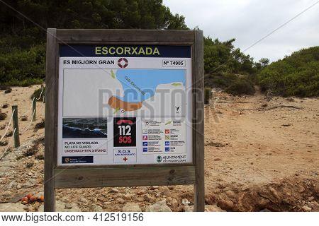 Es Migjorn Gran, Menorca / Spain - June 25, 2016: The Escorxada Beach Sign, Es Migjorn Gran, Menorca