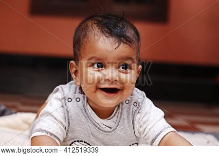 Cute Indian Baby Boy Lying On A Soft Baby Towel With Smile
