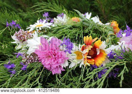 Midsummer Flower Wreath On The Green Grass Background. Scandinavian Summer Celebration. Greenery Wed