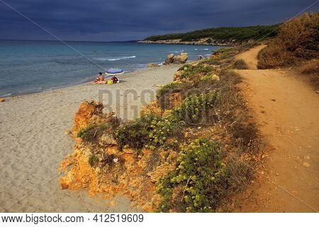 Sant Tomas, Menorca / Spain - June 25, 2016: The Binigaus Beach With Flowers, Sant Tomas, Menorca, B