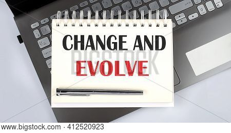 Change And Evolve - Top View Notebook Writing Helpful Tips On Laptop