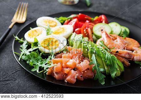 Ketogenic Diet Breakfast. Salt Salmon Salad With Boiled Shrimps, Prawns, Tomatoes, Cucumbers, Arugul