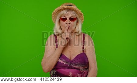 Elderly Woman Tourist Holding Finger Near Lips For Silence Sign, Hush, Secret, Silence On Chroma Key