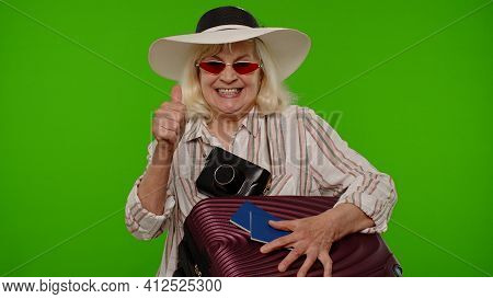 Senior Woman Photographer Traveler In Sunglasses Taking Picture Photos On Retro Camera, Thumb Up