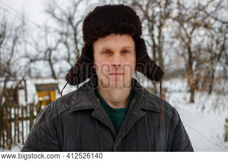 Peasant In Hat And Old Jacket In Winter Closeup
