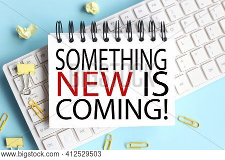 Something New Is Coming. Business Concept. Text On White Notepad Paper On White Keyboard