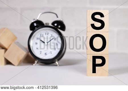 Sop As Standard Operating Procedure Conceptual Image. Text On Wood Cubes. Text In Black Letters On W