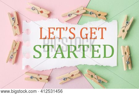Lets Get Started. Text On White Notepad Paper. On A Colorful Background.