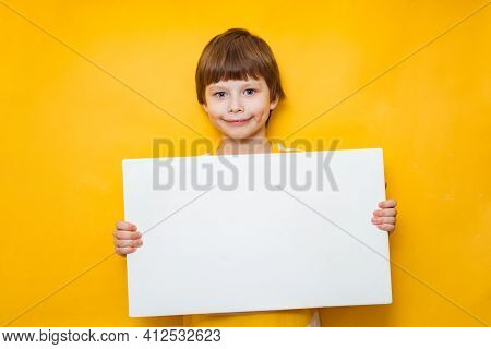 Boy Holds Blank Sign. Teen Boy Holds Empty Billboard. Boy Holds Blank Advertising Banner. Funny Boy