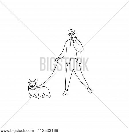 Happy Man Speaks On Phone And Walks Dog. Pretty Guy Holds Phone And Leads Dog On Leash. Male Walking