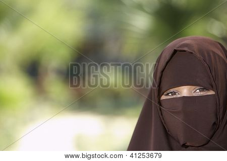 Portrait of a veiled Indian woman