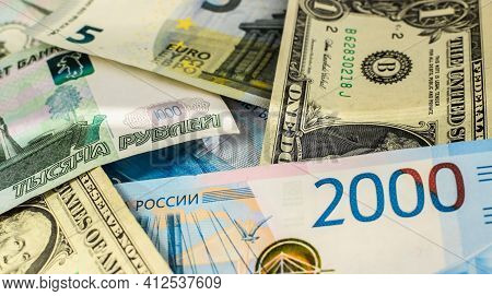 American Dollars, Euro Banknotes And Russian Rubles. Currency Exchange Concept. International Trade.