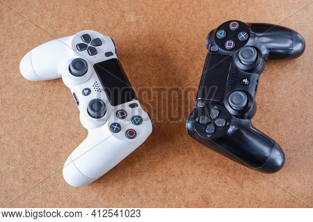Kyiv, Ukraine - March 03 2021: Sony Playstation 4 Gamepad. Close-up Photo Of A Black And White Gamep