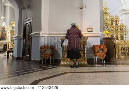 Omsk, Russia - September 13, 2019: Interior Of Golden Dormition Cathedral In Omsk With Praying Woman