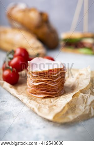 Vertical View Of A Pile, Stack Of Sliced, Smoked Dried Sausage On Food Wrapping Paper, On Stony Coun