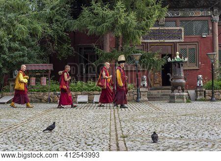 Ulaanbaatar, Mongolia - August 25, 2019: Gandantegchinlen Monastery In Ulaanbaatar With A Few Monks