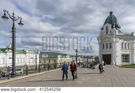 Omsk, Russia - September 13, 2019: People In The Streets Of Omsk With Great Architectural Buildings,