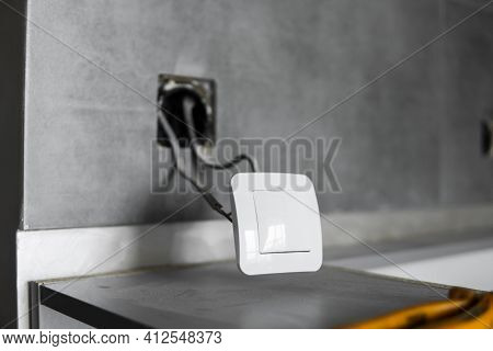 Repair Or Installation Of A New Light Switch In The Wall. Light Switch Connected Via Cables To A Ele