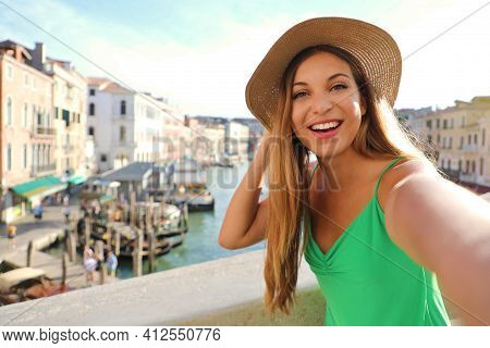 Venice Tourist Girl On Rialto Bridge Taking Selfie Photo With Famous Grand Canal On The Background.