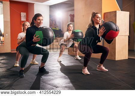 Joyous Athletic Women Staying In Shape By Exercising
