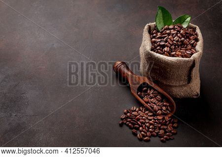 Roasted coffee beans in burlap bag. With copy space