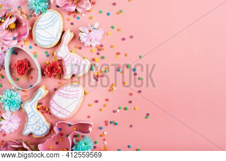 Sugar Sprinkles, Cookie Cutters, Easter Frosted Cookies In Shape Of Egg And Rabbit On Pink Backgroun