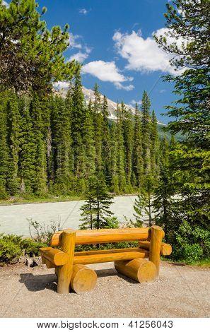 Picnic table near mountain river in Vancouver, Canada.