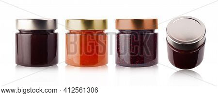 Front And Top View Of Set Of Small Jam Jars In Different Colors Without Labels And Shiny Metallic Li