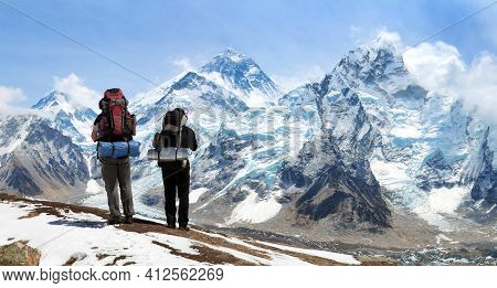 Panoramic View Of Mount Everest From Kala Patthar With Two Tourists And Signpost Way To Everest B.c.
