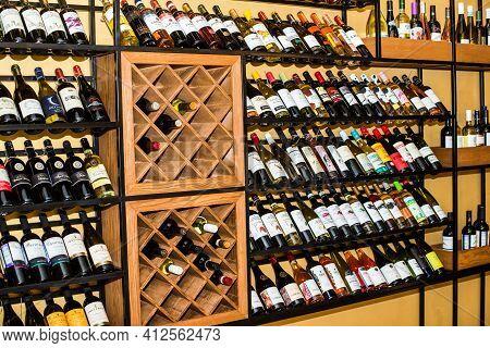 Krasnodar, Russia - March 2, 2021: Wooden Cabinet For Storing Wine Bottles. Showcase In A Restaurant
