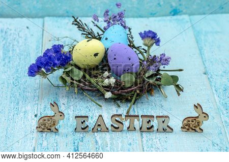 Happy Easter. Easter Eggs. Willow Twigs. Holy Easter. Blue Background. The Word Easter. Easter Bunny
