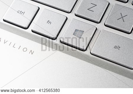 Sankt-petersburg, Russia, March 9, 2021: Laptop Computer With Windows Icon Key Button On Microsoft W