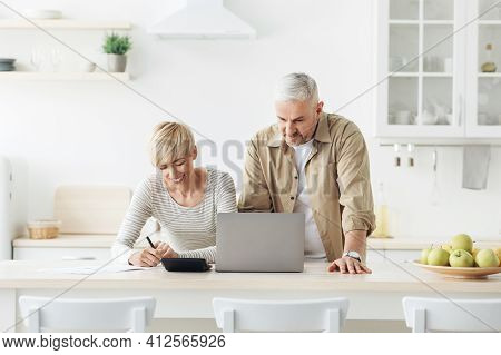 Home Bookkeeping, Bill Payment And Planning Budget, Reading Good News, Refund Or Mortgage Approval