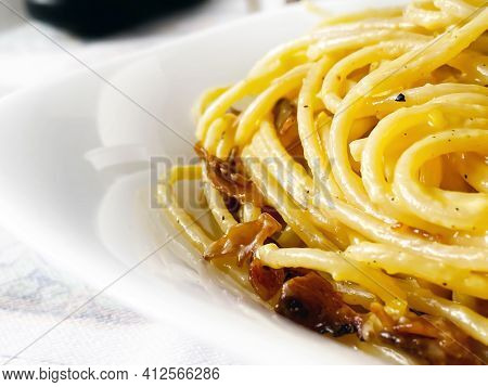 Detail Of Spaghetti Carbonara Served In A White Dish. Italian Food. Famous Typical Roman Recipe. Clo