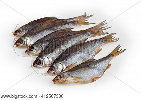 Bunch Of Several Salted And Air-dried Roach Fish On String On A White Background