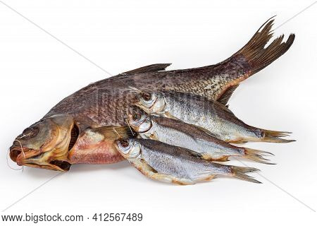 Salted And Air-dried Bream And Several Roach Fish On A White Background Close-up