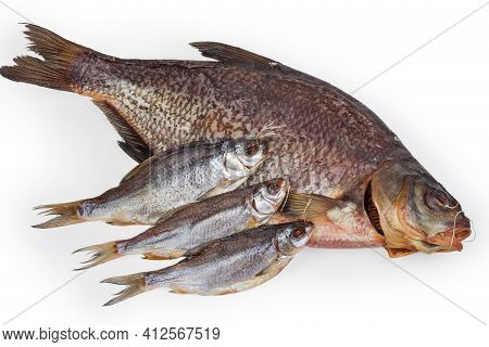Salted And Air-dried Big Bream And Several Roach Fish On A White Background, Top View Close-up