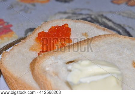 White Bread On A Board. Freshly Baked Bread. Like Baking Bread At Home. A Loaf Of White Bread