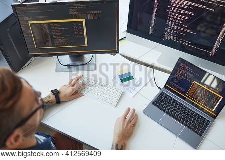 It Programmer Using Computers With Code On Screen