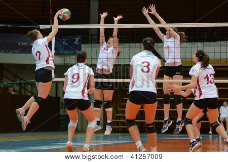 KAPOSVAR, HUNGARY - JANUARY 13: Zsanett Pinter (L) in action at the Hungarian I. League volleyball game Kaposvar (white) vs Budapest SE (white), January 13, 2013 in Kaposvar, Hungary.