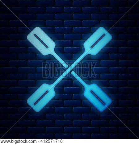 Glowing Neon Paddle Icon Isolated On Brick Wall Background. Paddle Boat Oars. Vector