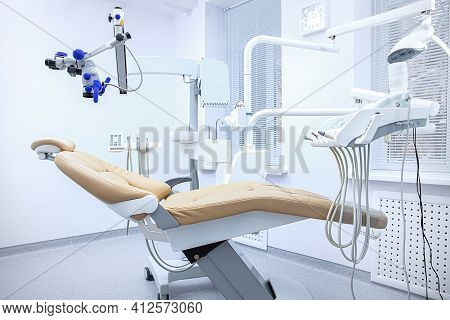 Special Equipment For A Dentist, Dentist Office. Medical Dental Chair For The Treatment Of Oral Prob