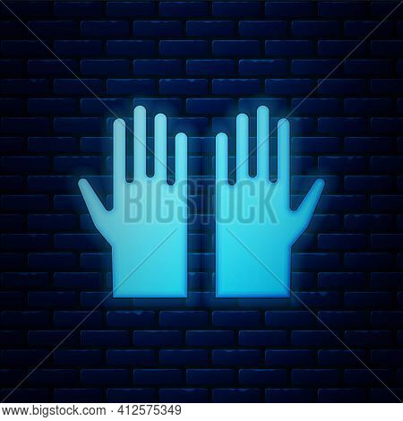 Glowing Neon Medical Rubber Gloves Icon Isolated On Brick Wall Background. Protective Rubber Gloves.