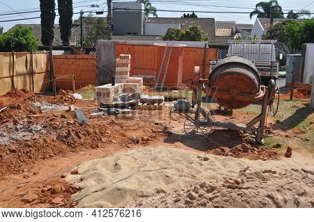 Construction Site. Construction Site In Brazil, With Earth, Sand, Blocks, Cement And Cement Mixing M