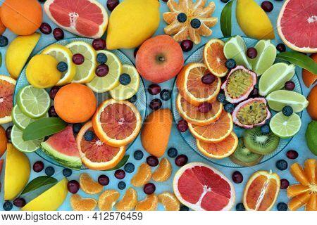 Fresh citrus fruit for vitamin c boost with cranberries, blueberries, oranges, lemons, limes  grapefruit high in antioxidants, anthocyanins, lycopene  fibre. Immune boosting health care concept.