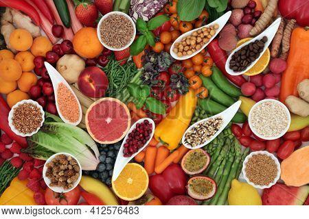 Plant based healthy antioxidant food for vegans with fruit, vegetables, cereals, grains, legumes, herbs  spice. High in fibre, protein, anthocyanins, lycopenes, vitamins, carotendoids, omega 3.