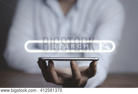 Businessman Holding Smartphone With Virtual Search Engine Browser, Information Technology Concept.